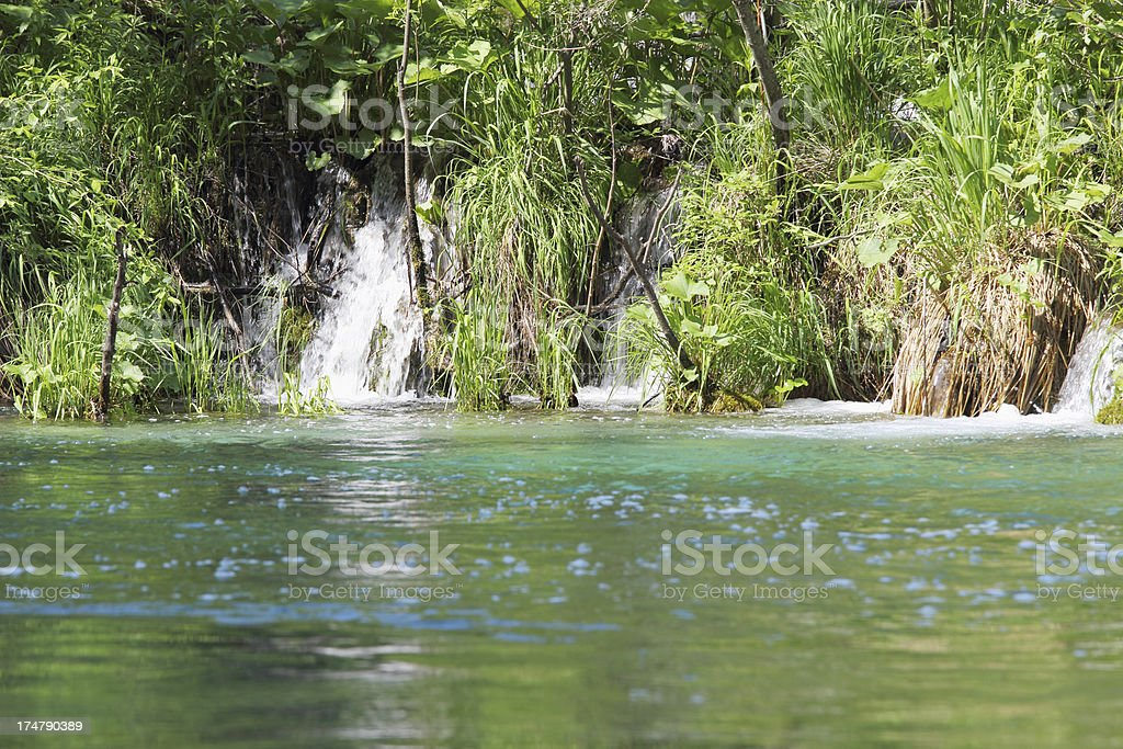 green turquoise lake with forest cascades Plitvice Croatia royalty-free stock photo