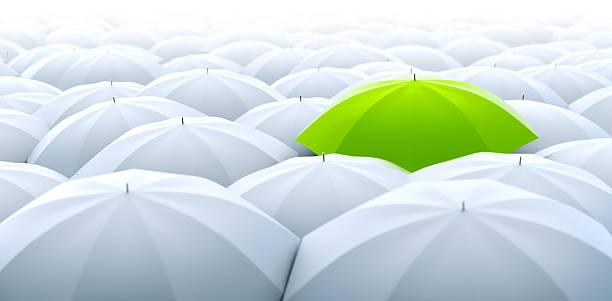green umbrella. different, leader, unique, boss, individuality, original, special concept - umbrellas stock photos and pictures