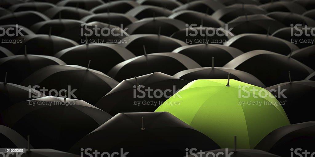Green umbrella in blacks stock photo