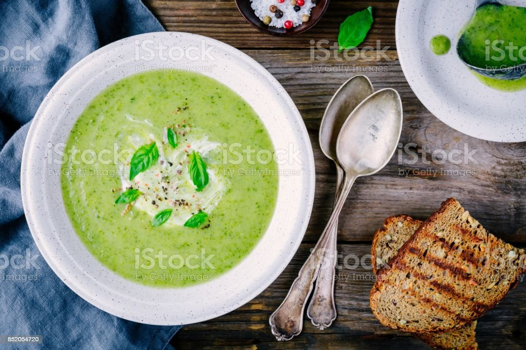 green vegetable cream soup puree with leek and basil stock photo