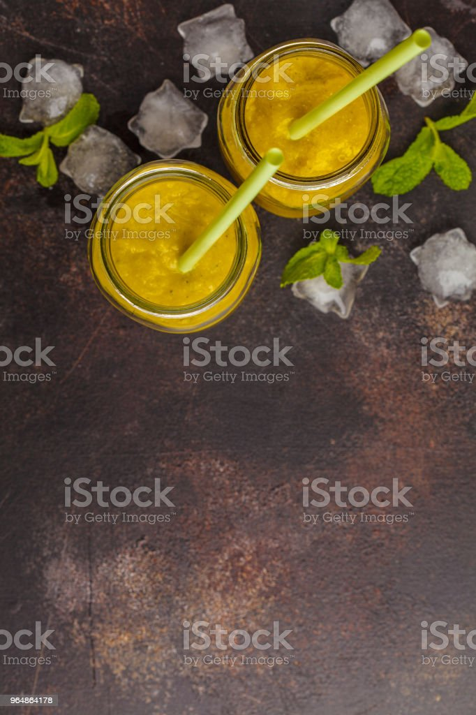 Green vegetable detox smoothies in a jar, top view, dark background. Healthy lifestyle concept. royalty-free stock photo