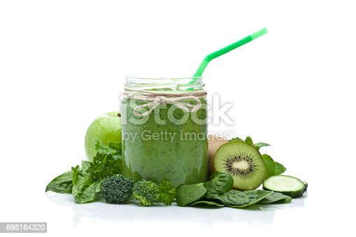 istock Green vegetable juice isolated on white background 695164320