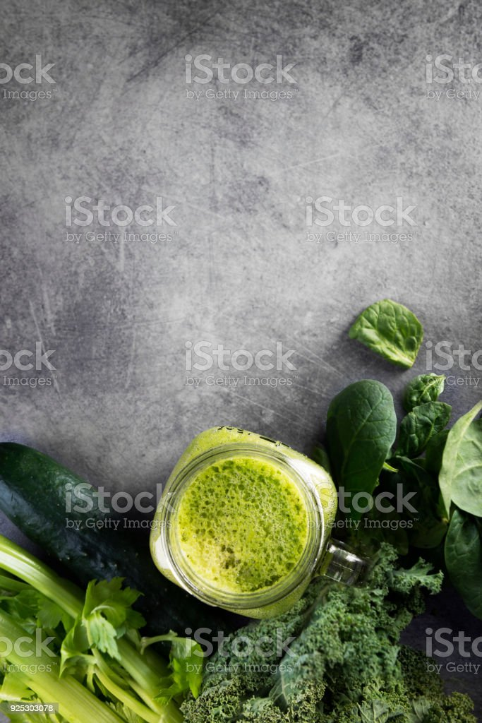 Green vegetable juice on concrete background stock photo