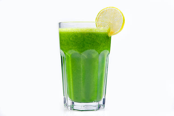 Green Vegetable Juice Glass full of green vegetable juice. Selective focus. Isolated on white.You can find more images of drinks and cocktails in this lightbox: vegetable juice stock pictures, royalty-free photos & images