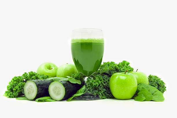 "Green vegetable juice ""Green drink vegetable juice made from organic apples, spinach, cucumbers and kale.More Fresh Juice:"" vegetable juice stock pictures, royalty-free photos & images"