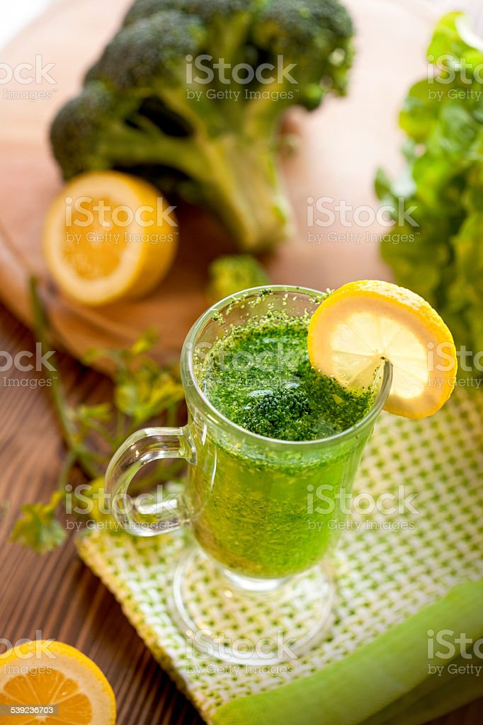 Green vegetable smoothie drink with brocolli royalty-free stock photo