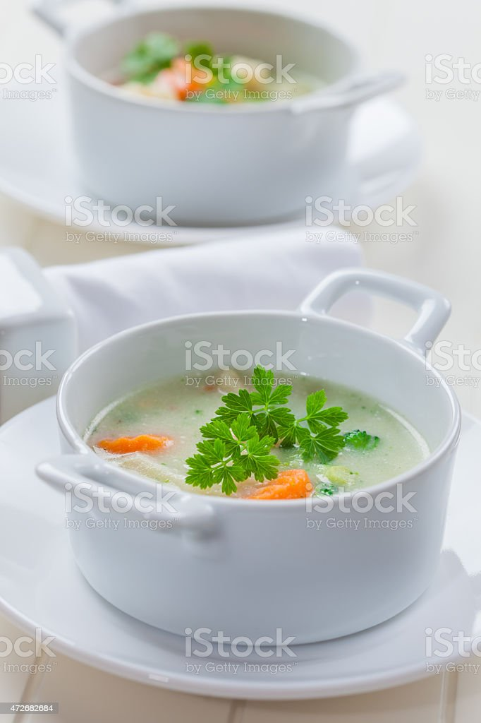Green vegetable soup with bulgur stock photo