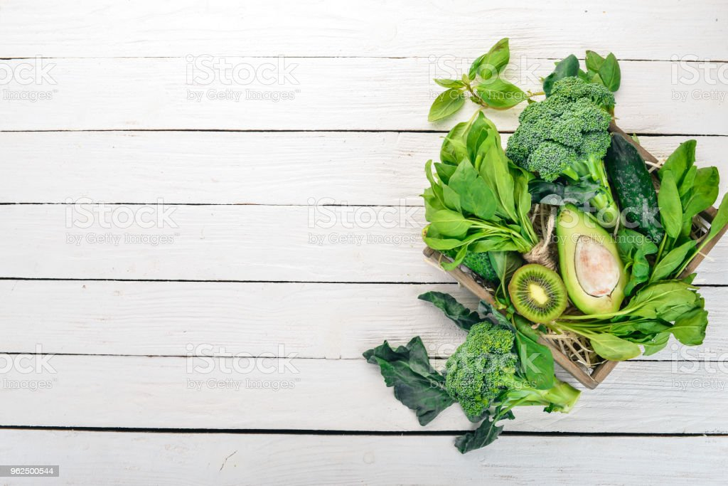 Green vegetables and fruits. On a white wooden background. Healthy food. Top view. Copy space. - Royalty-free Broccoli Stock Photo