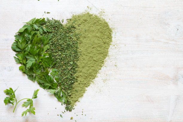 Green vegetables and herbs in heart health concept stock photo