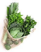 istock Green vegetables for healthy nutrition in net shopping bag 1190577644