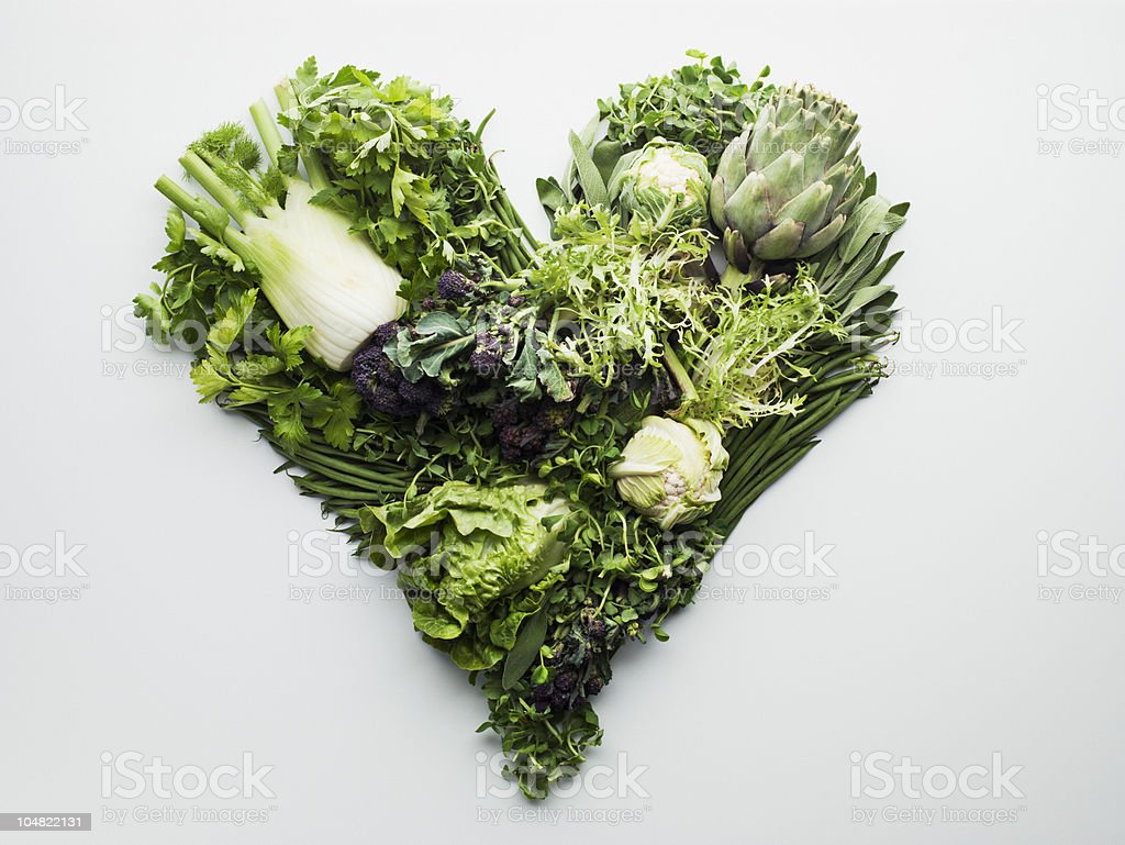 Green vegetables forming heart-shape stock photo