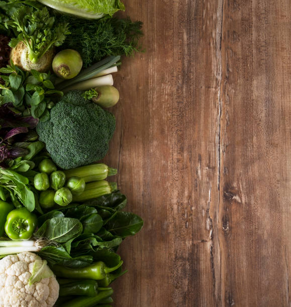 Green Vegetables on Kitchen Table - foto stock