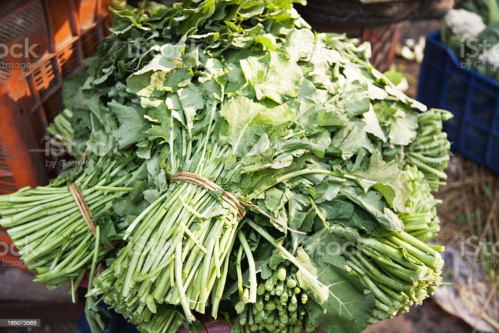 green vegetables on market in India stock photo