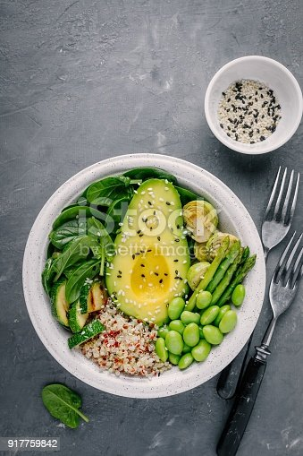 istock Green vegetarian buddha bowl lunch with grilled vegetables and quinoa, spinach, avocado, brussels sprouts, zucchini, asparagus, edamame beans 917759842