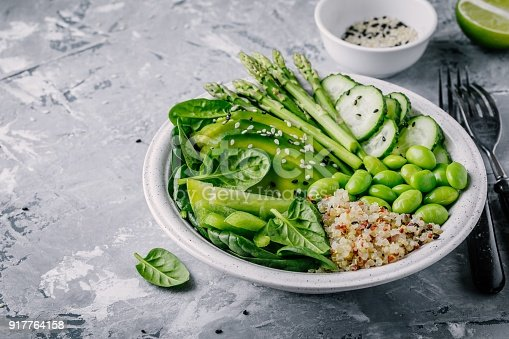 istock Green vegetarian buddha bowl salad with fresh vegetables and quinoa, spinach, avocado, asparagus, cucumber, edamame beans 917764158