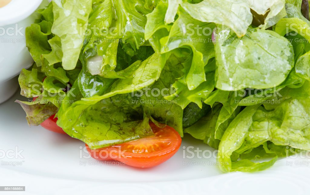 Green vegetarian salad with tomato cherry royalty-free stock photo