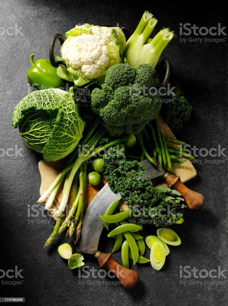 Green Vegtables on a Wooden Chopping Board stock photo