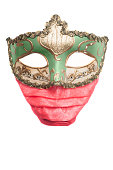 Green venetian mask wearing a red surgical mask, isolated on white background