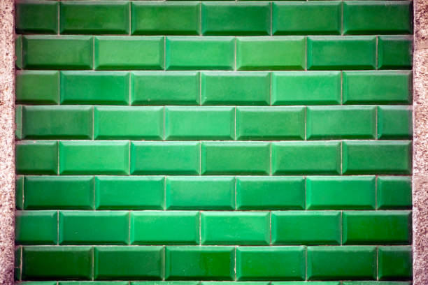 Green vintage tiles background, stone framed. stock photo