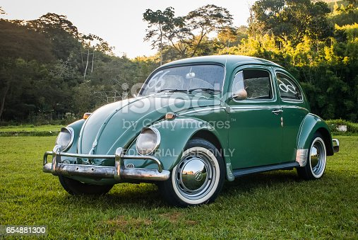 Rio de Janeiro, Brazil - July 27, 2012: A green Beetle is seen stooped at a filed in the rural area of Valencia city, southeast of Brazil. The vehicle is produced by Volkswagen Group, a German multinational automotive manufacturing company headquartered in Wolfsburg, Lower Saxony, Germany.