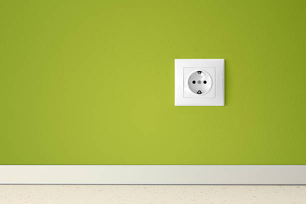 Green wall with european electric outlet Green wall with european electric outlet electrical outlet stock pictures, royalty-free photos & images