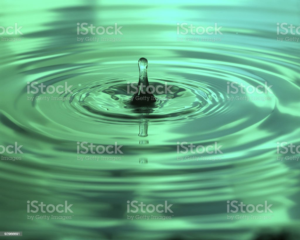 Green water drip and ripples stock photo