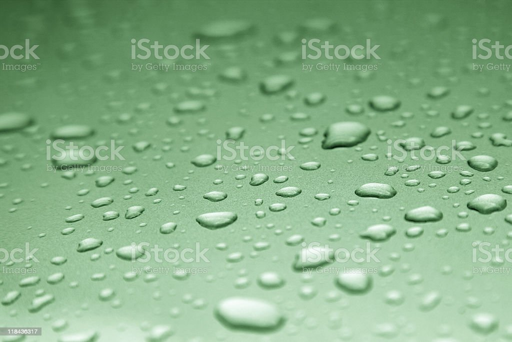green water drops on smooth surface royalty-free stock photo