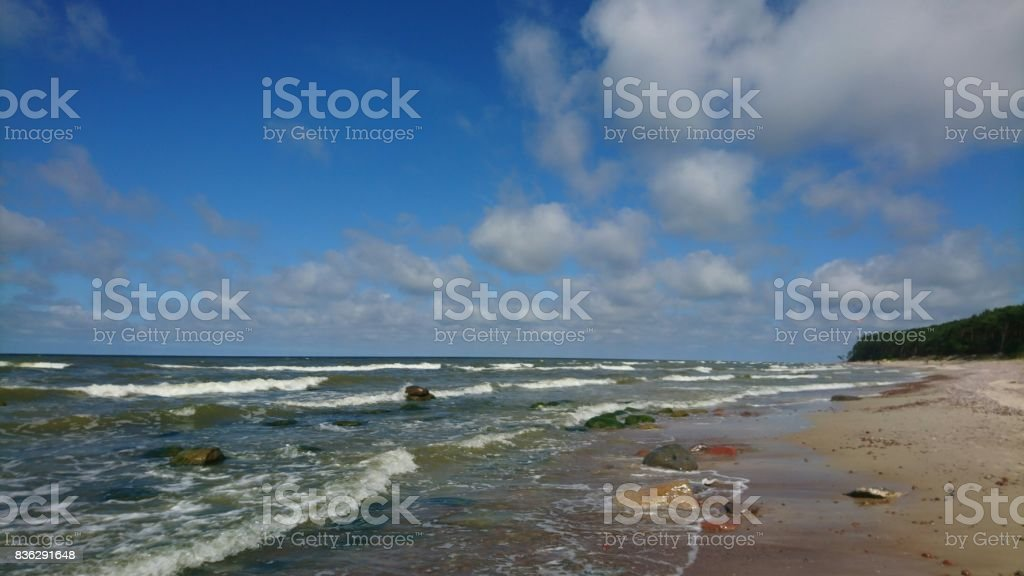 Green water of sea in windy day of summer stock photo