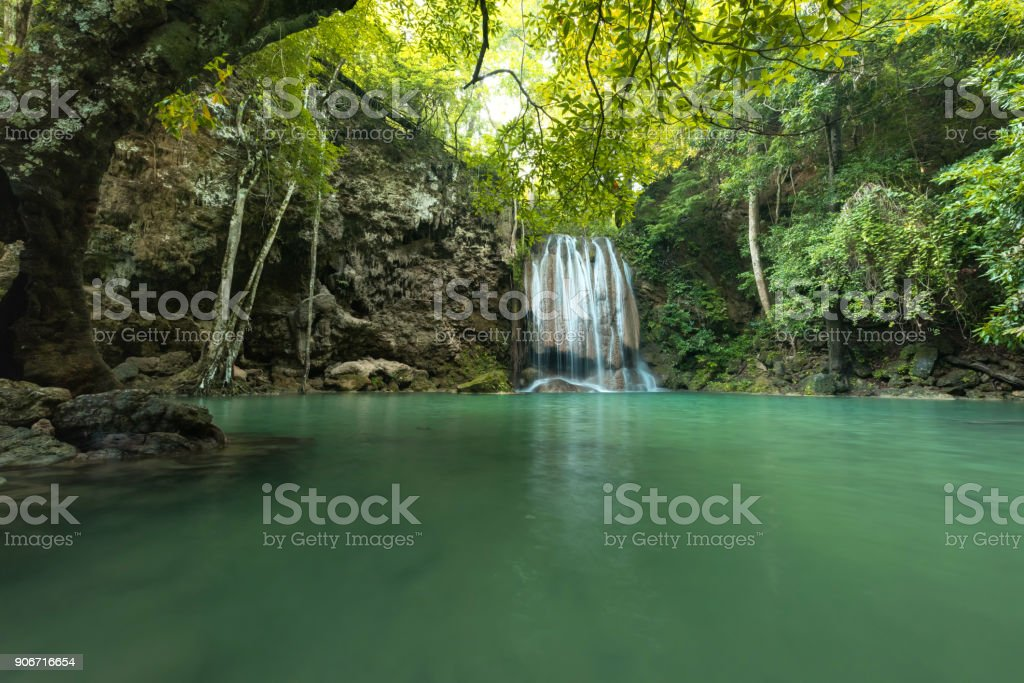Green waterfall at deep forest, Erawan waterfall located Kanchanaburi Province stock photo