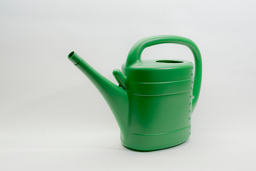 green watering can, isolated
