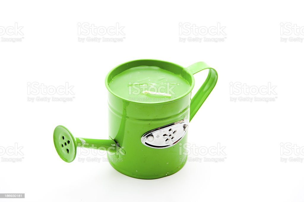 Green watering can with candle stock photo