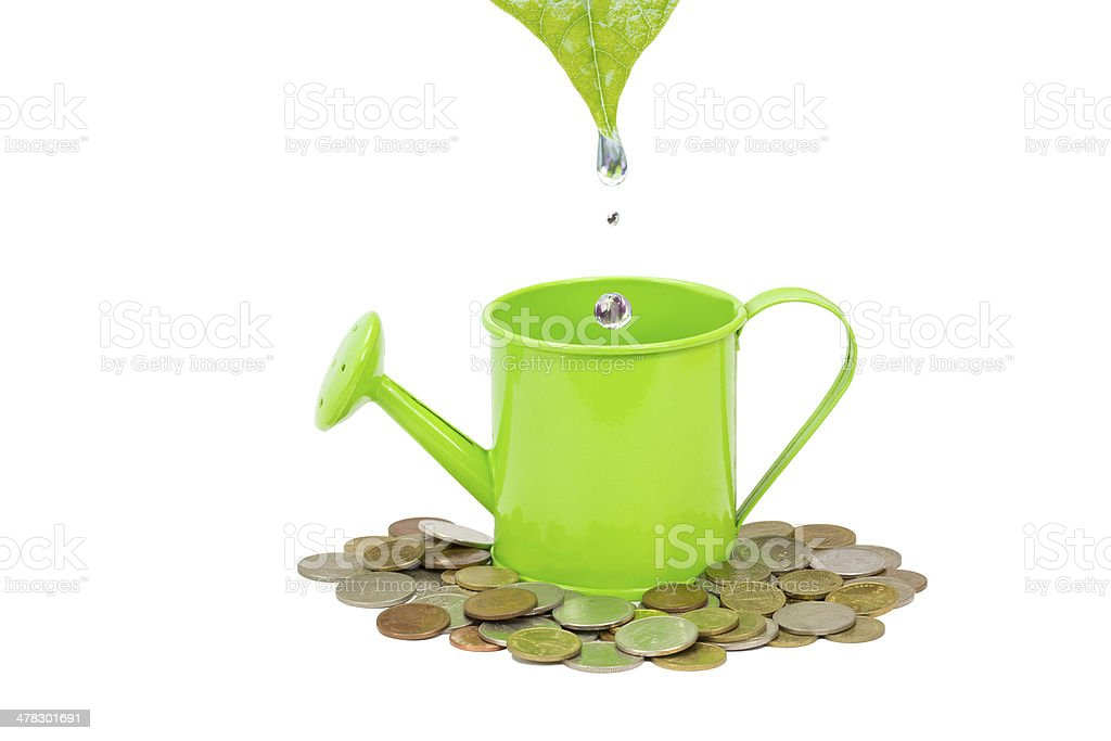 green watering can with drops isolated on white royalty-free stock photo
