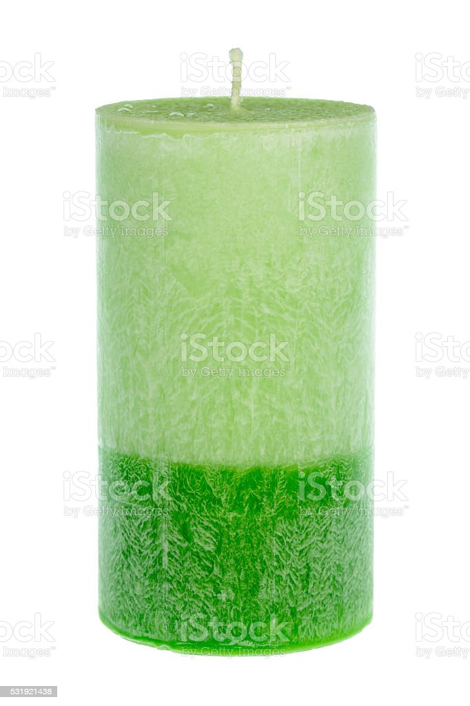 Green wax candle isolated. stock photo