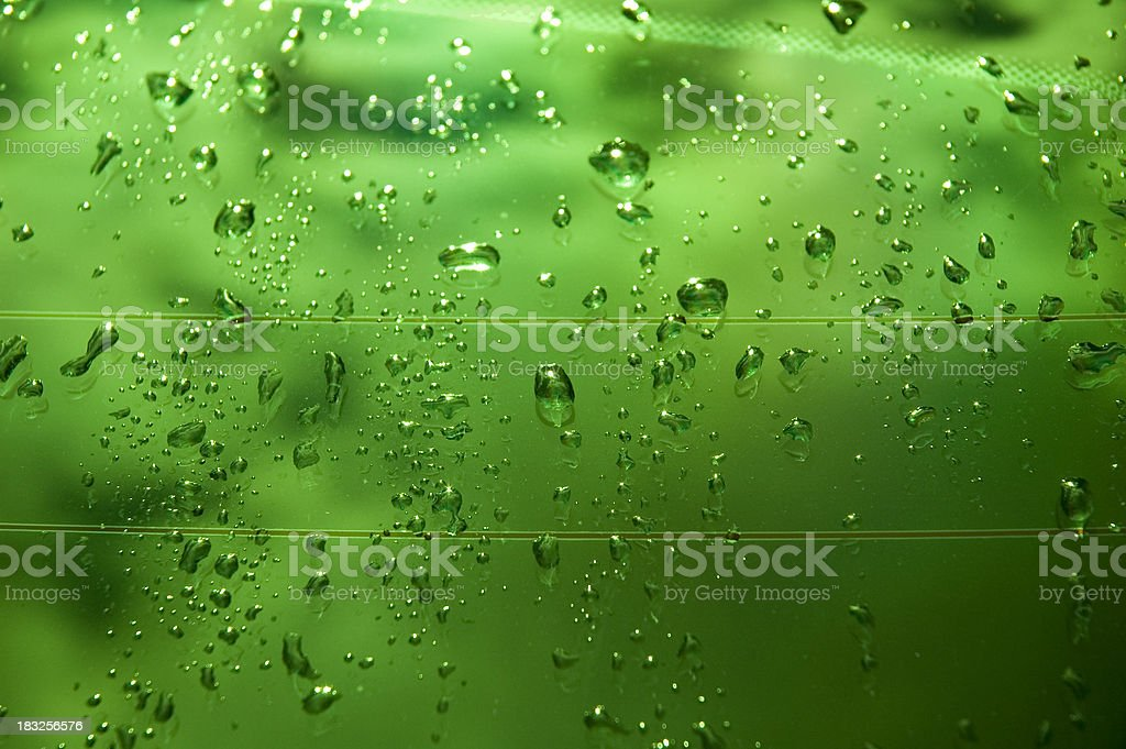 Green wet glass stock photo