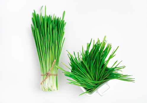 Green wheat Grass on a white background. The view from the top. The concept of healthy food, Superfoods.