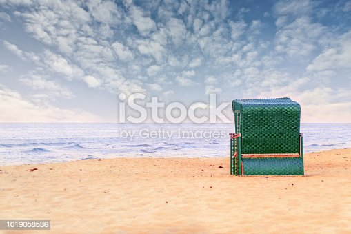 istock green wicker beach chair alone by the romantic baltic sea 1019058536