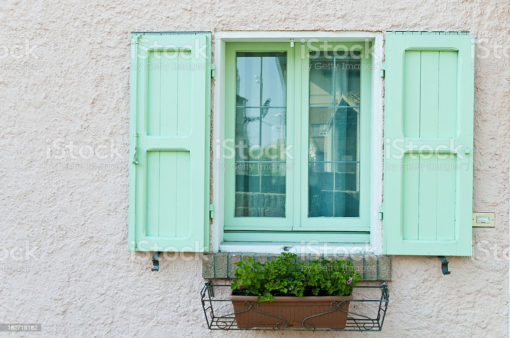 Green Window On white Wall In Italy royalty-free stock photo