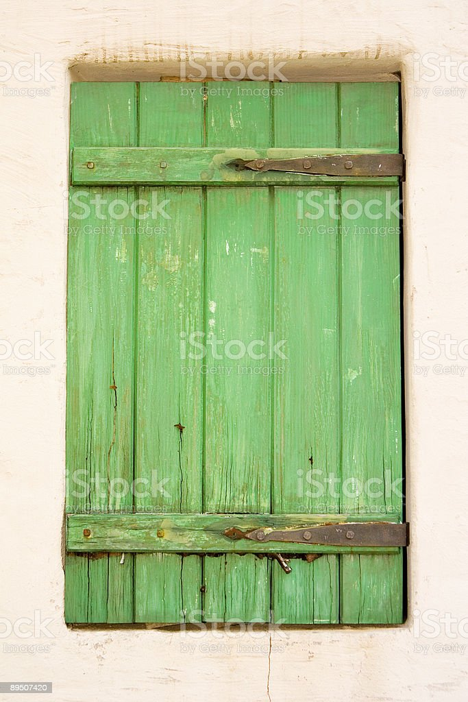 Green window with shutter royalty-free stock photo