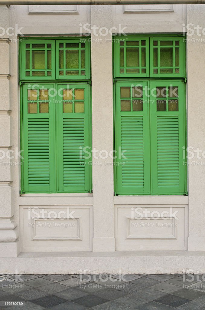 green windows on a concrete wall royalty-free stock photo