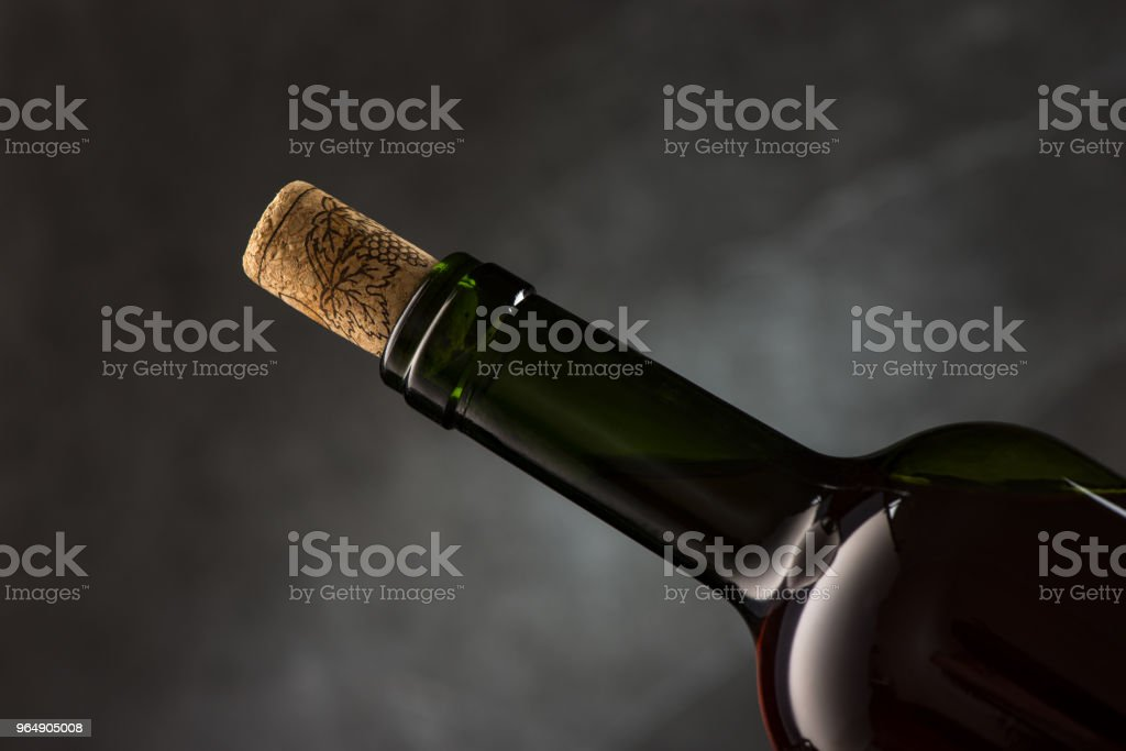 Green wine bottle with cork royalty-free stock photo