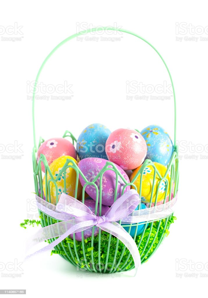 A Green Wire Easter Basket Filled with Decorated Eggs Isolated on a White Background royalty-free stock photo