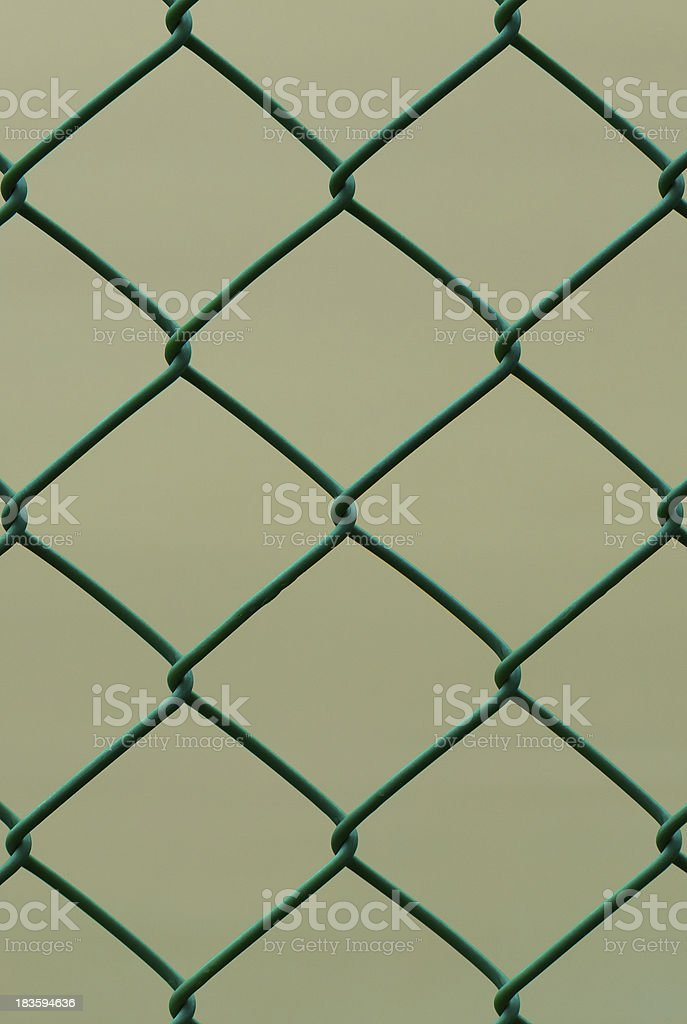 Green Wire Fence isolated on Brown Background, Vertical pattern royalty-free stock photo