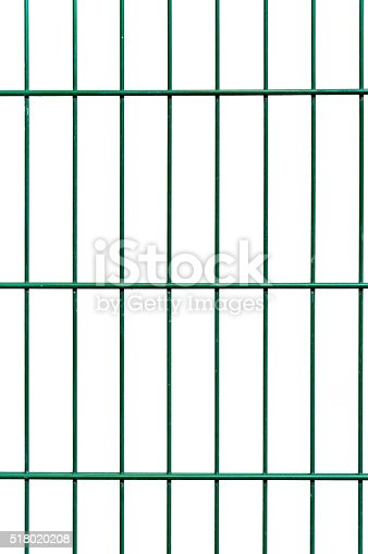 istock Green wire netting fence before white wall background 518020208