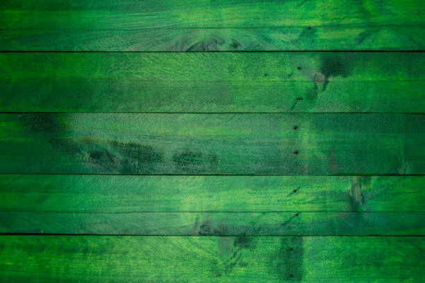 green wood background in used look - green color stock photos and pictures