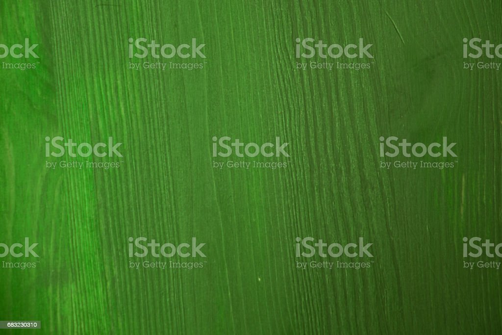 Green wood texture. Green wood background. Closeup view of green wood texture and background. Abstract background and texture for designers. Texture of green vintage handmade table. Rustic table. 免版稅 stock photo