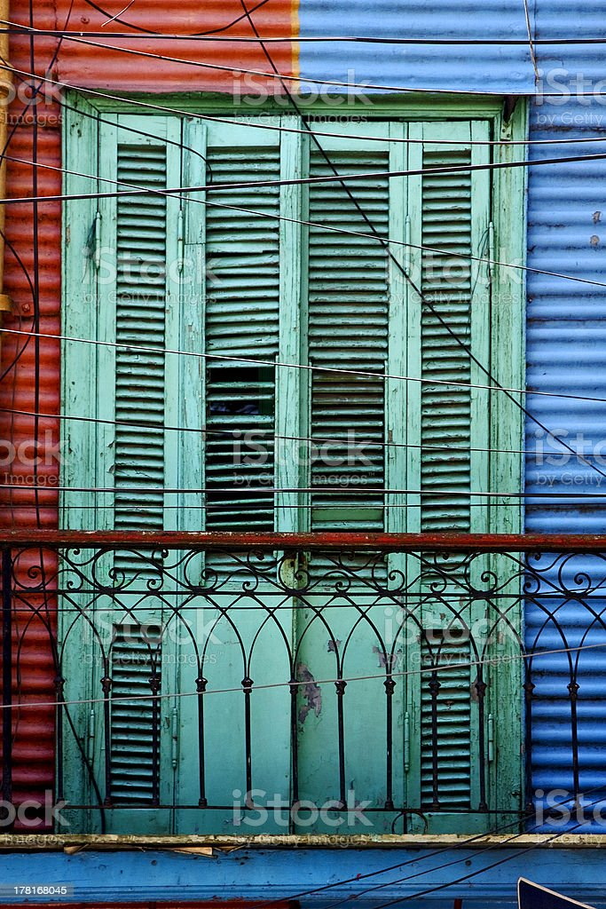 green wood venetian blind and a red blue wall royalty-free stock photo