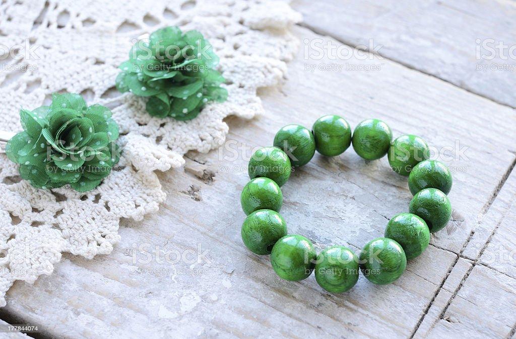Green wooden beads bracelet royalty-free stock photo