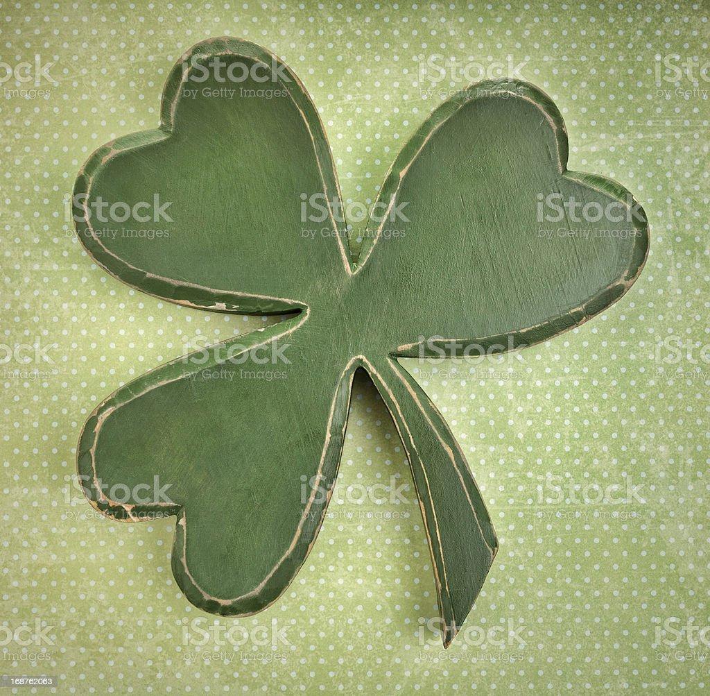 Green wooden shamrock on vintage polka dot  texture royalty-free stock photo