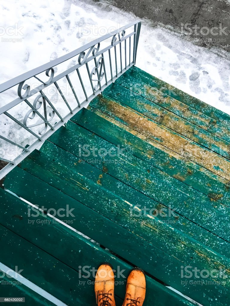 Green wooden staircase and winter street royalty-free stock photo