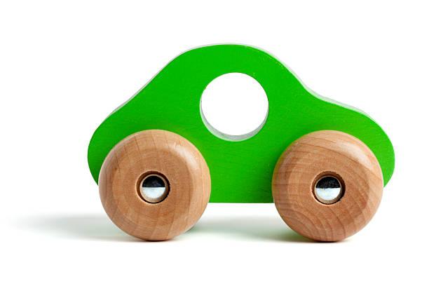 green wooden toy car - holzspielwaren stock-fotos und bilder